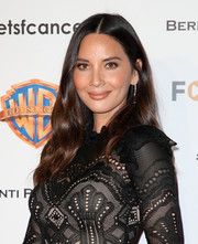 Olivia Munn looked beautiful with her center-parted wavy hairstyle at the Barbara Berlanti Heroes Gala.