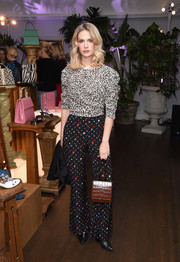 January Jones took a style risk, clashing her leopard top with multicolored dotted pants.