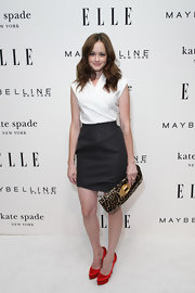 Alexis topped off her high-waisted skirt with stunning satin Paloma pumps.