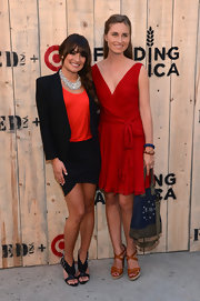 Lea Michele contrasted her structured jacket with a sexy asymmetrical-hem mini skirt at the Feed USA + Target launch.