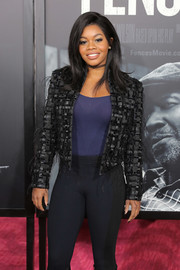 Gabrielle Douglas attended the New York screening of 'Fences' wearing a feather-embellished cropped jacket.