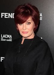 Sharon showed off her side swept bangs and short straight cut while hitting the FENDI party.