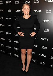 Erika showed off a bold shoulder cocktail dress while hitting the FENDI boutique opening.