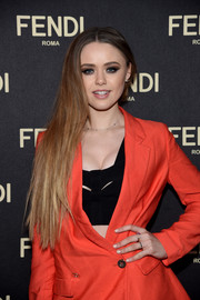 Kristina Bazan wore her ultra-long locks down in a straight center-parted style for the Fendi New York flagship store opening.