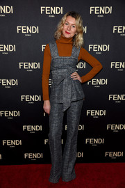 Natalie Joos layered a bow-accented gray pinafore top over a rust-colored turtleneck for the Fendi New York flagship store opening.