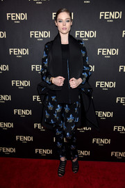 Coco Rocha worked the red carpet in a Fendi orchid-print pantsuit during the label's New York flagship store opening.