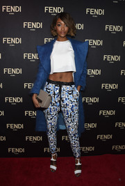 Jourdan Dunn layered a blue Fendi mohair coat over her shirt for added warmth and style.