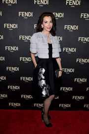 Fe Fendi looked flawless in a cropped gray fur jacket layered over a little black dress at the Fendi New York flagship store opening.
