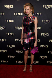Petra Nemcova rounded out her colorful ensemble with a hot-pink leather purse.