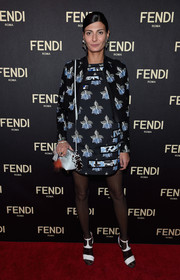 Giovanna Battaglia sported a Fendi jacket and dress set, featuring the SS15 collection's signature orchid print, during the label's New York flagship store opening.