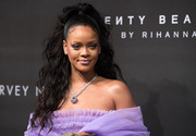 Rihanna worked a glamorous half-up wavy style at the Fenty Beauty launch.