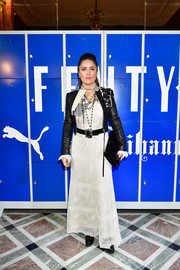 Salma Hayek went boho in a lacy white maxi dress by Alexander McQueen for the Fenty x Puma fashion show.