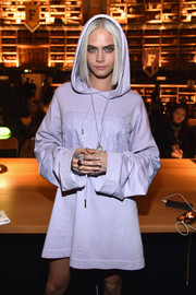 Cara Delevingne channeled her inner high priestess with this loose, hooded top by Fenty x Puma during the brand's fashion show.