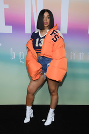 Cardi B rounded out her look with a pair of white ankle boots.