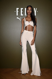 Jourdan Dunn rocked a '70s-inspired matchy-matchy look with this lace-up bell-bottoms and crop-top combo.