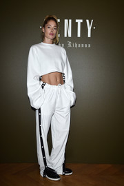 Doutzen Kroes matched her top with a pair of side-striped pants, also by Fenty x Puma.