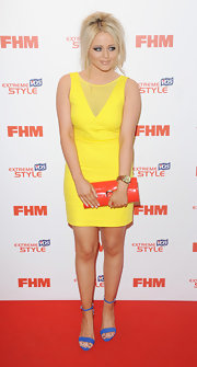 Emily Atack chose a sunshine yellow cocktail dress for a bright and cheerful red carpet look.