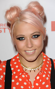 Amelia Lily pulled back her punk-inspired cotton candy pink hair into cool top knots.