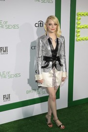 Emma Stone looked snazzy in a silver and black jacket layered over a striped shirtdress, both by Louis Vuitton, at the LA premiere of 'Battle of the Sexes.'