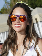 Alessandra Ambrosio rocked a pair of purple and orange mirror sunglasses.