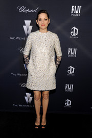 Marion Cotillard was all about retro elegance at the Weinstein Company Oscar nominees dinner in a heavily beaded Christian Dior Couture shift dress, which came with black lace sleeve extensions.