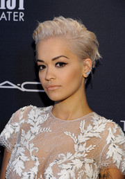 Rita Ora contrasted her ultra-feminine dress with a punky, messy 'do when she attended the Weinstein Company Oscar nominees dinner.