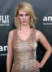 January Jones accessorized with a pair of Bulgari diamond rings for added sparkle to her sequined dress at the 2014 amfAR Inspiration Gala.