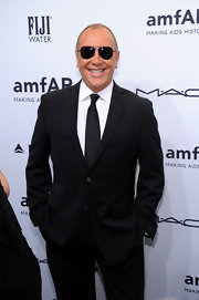 Michael Kors is tres chic in dark aviator sunglasses at the amfAR New York Gala.
