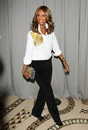 Iman accessorized her black and white ensemble at the FIT soiree with a print clutch complete with gold detailing.