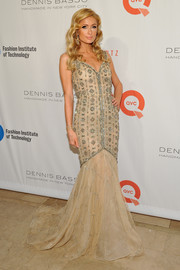 Paris Hilton looked positively regal in a beaded nude mermaid gown by Dennis Basso at the FIT Gala.