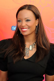 Aisha Tyler paired her statement necklace with long flowing locks.