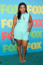 Mindy Kaling attended the Fox Programming Presentation wearing a turquoise Miu Miu top featuring a beaded neckline and peekaboo detailing.