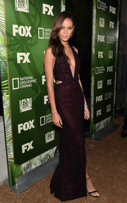Joan Smalls paired her gown with simple black ankle-strap sandals by Alexander McQueen.