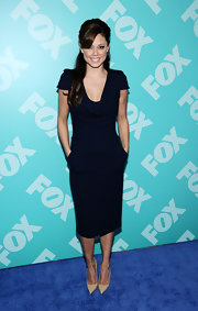 Vanessa Lachey showed off her tiny figure in this fitted sheath dress that featured a draped cowl neck and pockets.