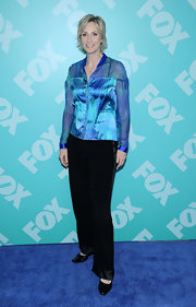 Jane Lynch's blue satin blouse gave her tomboy style a fun pop of color.