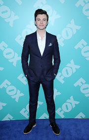 Chris Colfer chose a classic two-button suit in a deep navy for his cool and contemporary look at FOX's programming party.