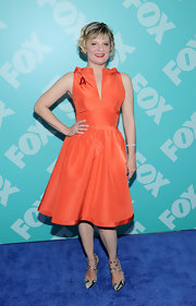Martha Plimpton showed she knows how to rock a bold color at the FOX programming party, where she wore a bright orange A-line frock.