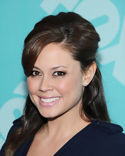 To keep give her hair a touch of retro flare, Vanessa Lachey opted for a teased half up, half down 'do.