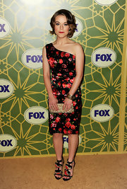 Tina Majorino made quite a statement on the red carpet in a one-shoulder printed cocktail dress. She paired the look with embellished strappy sandals.
