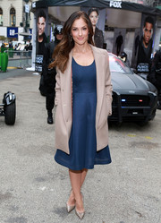 Minka Kelly was fall-chic in a beige coat layered over a blue cocktail dress at the Almost Human-hattan event.