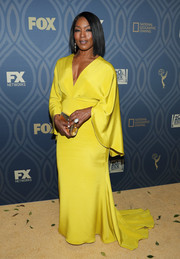 Angela Bassett was an elegant standout in a bright yellow Christian Siriano gown during Fox Broadcasting's Emmy after-party.