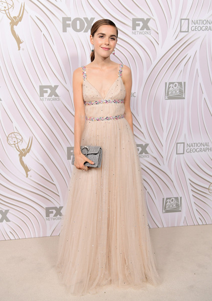 Kiernan Shipka paired a gray matelasse clutch with a nude tulle gown (both by Miu Miu) for Fox's Emmy Awards after-party.