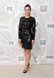 Sophia Bush styled her dress with a pair of black and gold platform sandals by Ferragamo.