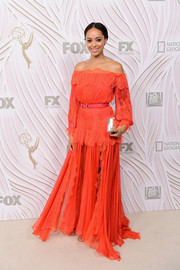 Amber Stevens West was a boho beauty in an orange off-the-shoulder maxi dress during Fox's Emmy Awards after-party.