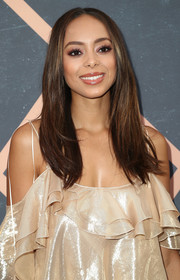 Amber Stevens West kept it simple with this loose center-parted style at the Fox Fall party.