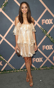 Amber Stevens West was boudoir-glam in a gold ruffle cold-shoulder dress by Paule Ka at the Fox Fall party.