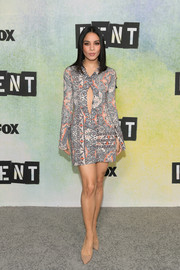 Vanessa Hudgens teamed her stylish dress with basic nude pumps by Brian Atwood.