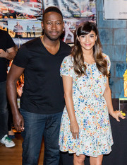 Hannah Simone kept it youthful and breezy in a loose floral dress during the 'New Girl' 100th episode cake-cutting event.