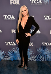 Jenny McCarthy paired her sexy dress with bejeweled black sandals.