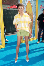Zendaya Coleman continued the breezy vibe with a pair of green short shorts, also by Jacquemus.